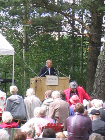 Persson addresses the crowd
